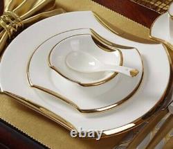 Luxury, oval shape gold banded white Fine Bone China dinner set, service for 4
